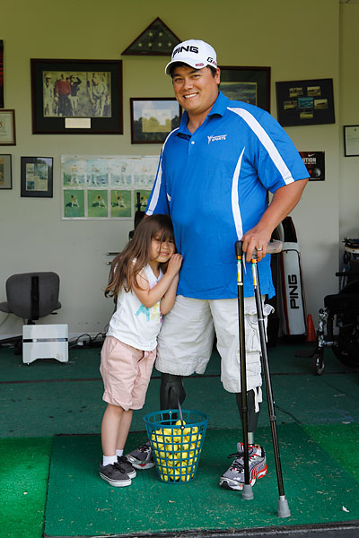 Isabelle puts a smile on her father's face, but asking Mark Holbert to play golf from a wheelchair will elicit a different reaction.