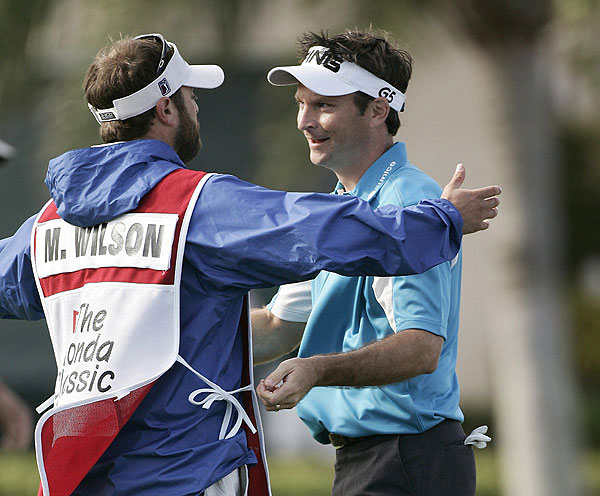 Mark Wilson, who made 10 consecutive trips through Q-school and had never won on Tour, celebrated the victory at the Honda with his caddie, Chris Jones.