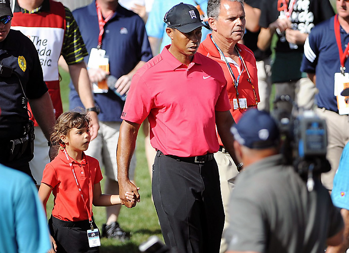 2014 Honda Classic: Woods threw in the towel 13 holes into the final round of the Honda Classic, shaking hands with playing partner Luke Guthrie and walking off the course with his daughter Sam. He cited a lower back injury and back spasms as the reason for his withdrawal.