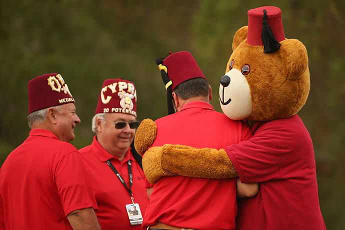 The Shriners mascot hugs a volunteer on the first tee Saturday during the third round of the Shriners Hospitals For Children Open at TPC Summerlin in Las Vegas.