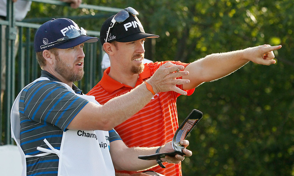 Hunter Mahan checked yardages with his caddie John Wood.