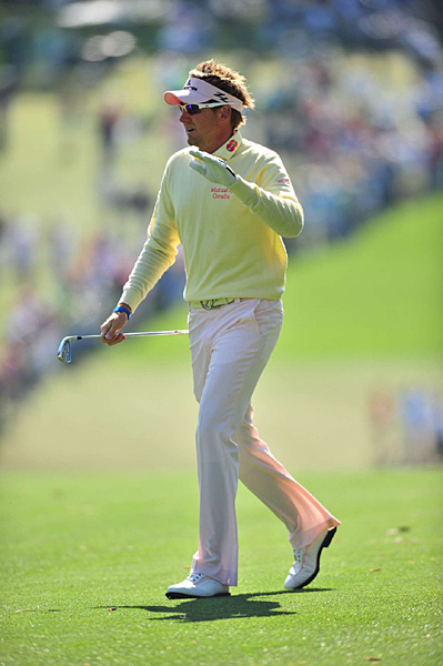 Poulter is known for his flashy clothes, but his game was rock solid Friday.