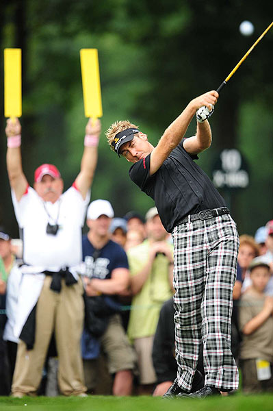 "Ian Poulter's three birdies and three bogeys left him with an even-par 70.                                                                                                                                                                                                                         function fbs_click() {u=""http://www.golf.com/golf/gallery/article/0,28242,1905392,00.html"";t=document.title;window.open('http://www.facebook.com/sharer.php?u='+encodeURIComponent(u)+'&t='+encodeURIComponent(t),'sharer','toolbar=0,status=0,width=626,height=436');return false;} html .fb_share_link { padding:2px 0 0 20px; height:16px; background:url(http://b.static.ak.fbcdn.net/images/share/facebook_share_icon.gif?8:26981) no-repeat top left; }Share on Facebook                                                                                                                                                                                                                        addthis_pub             = 'golf';                                                       addthis_logo            = 'http://s9.addthis.com/custom/golf/golf_logo.jpg';                                                      var addthis_offset_top = -155;                                                      addthis_logo_color      = '555555';                                                      addthis_brand           = 'Golf.com';                                                      addthis_options         = 'email, facebook, twitter, digg, delicious, myspace, google, reddit, live, more'                                                                                                                                                                    Share"