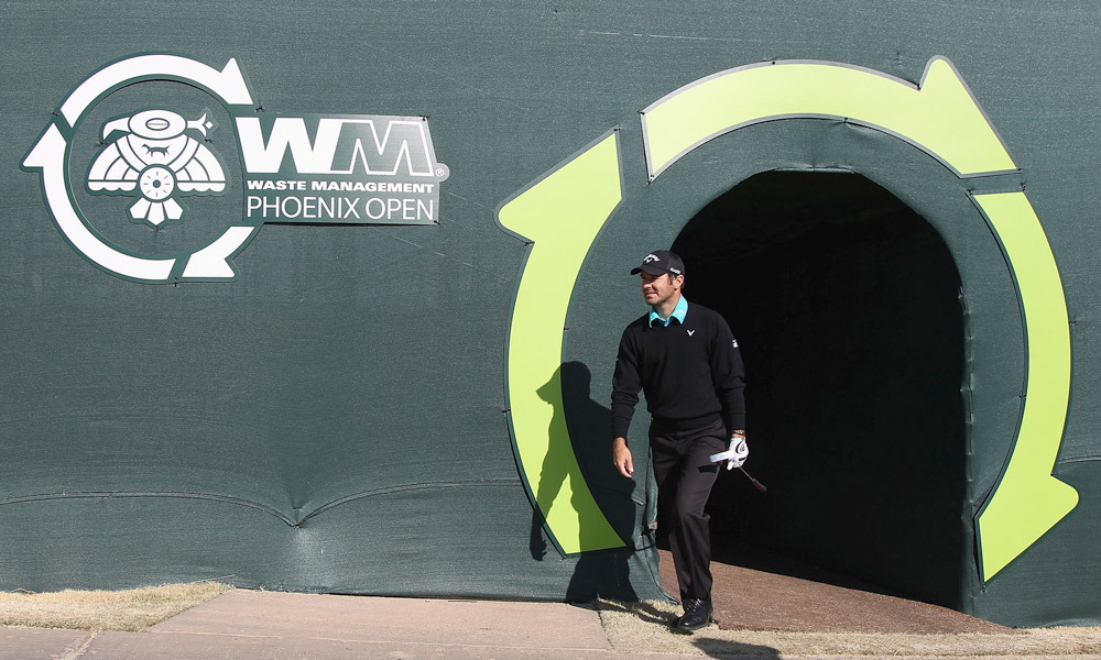 Trevor Immelman shot a four-under 67. Here he enters through the tunnel into the stadium-like 16th hole.