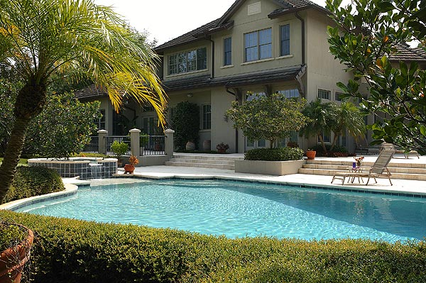 The backyard also features a heated pool, spa and summer kitchen.