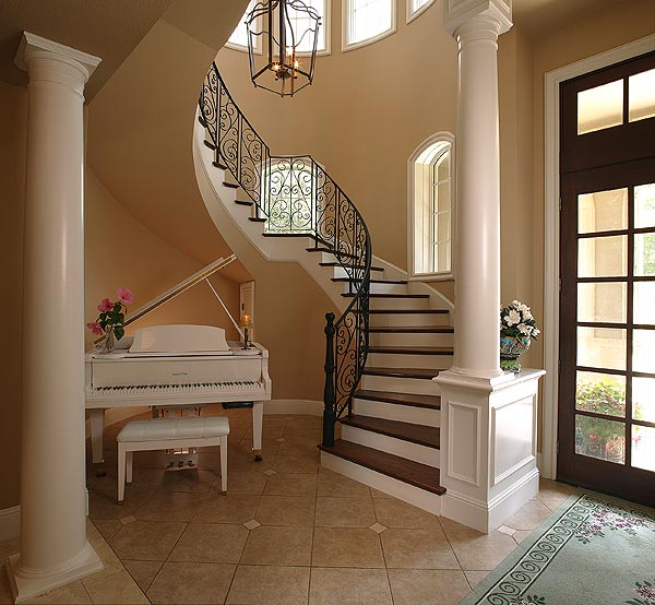 A spiral staircase near the front door. The house has six bedrooms and seven and a half baths.