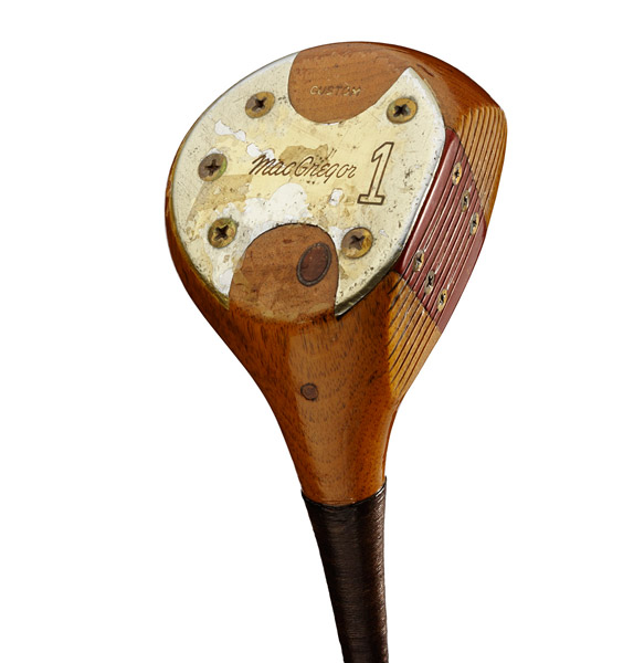 "MacGregor Jack Nicklaus CustomUsed by Jack: 1966-1974Manufactured: 1966Majors won: 1966 and '72 Masters; '67 and '72 U.S. Open; '71 and '73 PGA Championship.Technology: The persimmon head is finished with five coats of acrylate epoxy for protection. A four-way roll face — toe to heel, crown to sole — creates ""gear effect"" so off-center shots won't curve as far offline.History: MacGregor made this exact duplicate of the 1960 MacGregor Tommy Armour SS1W after Nicklaus cracked the original in the 1966 match with Player in South Africa."