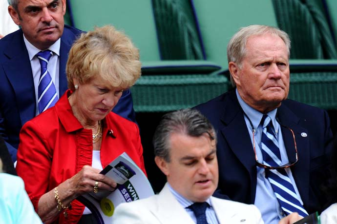 """If you're going to win majors in any sport, you've got to win the first one and once you get the first one under your belt, the others come a little easier.""                           --Tennis fan Jack Nicklaus on the similarities between golf and tennis. Photo of Nicklaus watching the Wimbledon with wife Barbara."