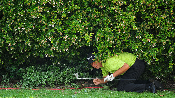 South African Keith Horne got down low to play this shot under a bush on the 14th hole.