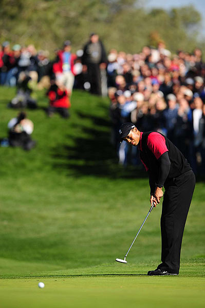 A birdie putt on 18 gave Woods an eight-shot victory, and earned him a fourth straight title at the Buick.