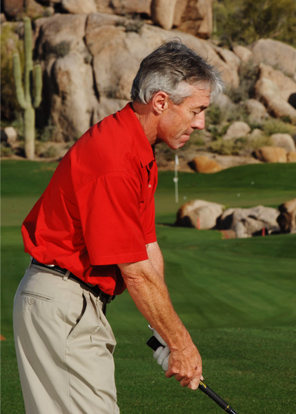 STEP 2                           KEEP YOUR CHIN UP Just before you start your swing, raise your chin a few inches. Point just your eyes down — not your entire head — to see the ball in your stance. This simple move creates extra room so that you can extend your arms fully at impact.