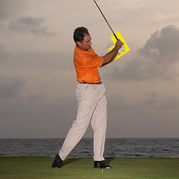 Your swing's momentum should cause your wrists to rehinge after impact. If they don't, it means you held on too long and drained your swing of power and speed.