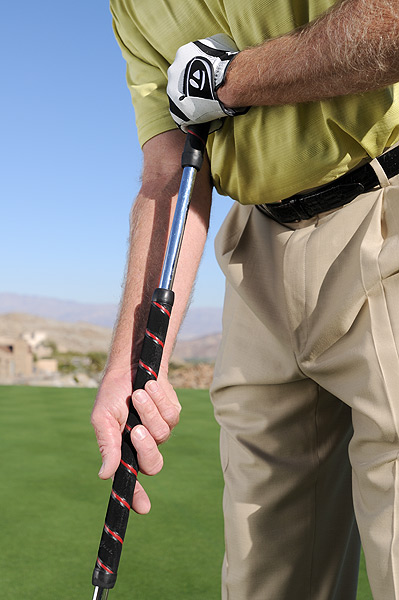 Try This!                           A BELLY putter cures the yips because it takes your hands and wrists (the moving parts that cause the yips) out of your stroke. Here's how to use it.                                                      1. Hold the grip in the palm of your right hand so the shaft is in line with your right forearm. Your right arm should be hanging fairly relaxed.                                                      2. Hold the top of the grip with your left hand so that your left forearm is parallel with the ground.                                                      3. Make your putting stroke with your shoulders while maintaining the angles in your right and left forearms that you established at setup.