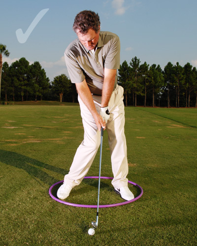If you tend to hit your irons thin...                                              Focus on your downswing hip turn. Try to turn your left                       hip along the left-hand side of the hoop                       (keep your left hip above your left foot). When                       your left hip slides outside the hoop, you'll                       tend to hit down on the top of the ball. If you                       do it correctly, you should feel your weight                       move only into the heel of your left foot.