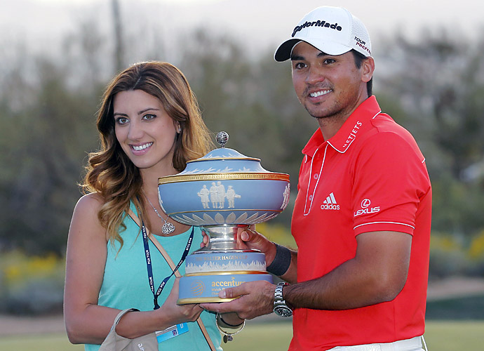 Ellie and Jason Day hoist the World Match Play Championship trophy. It was the second PGA Tour title of Day's career.