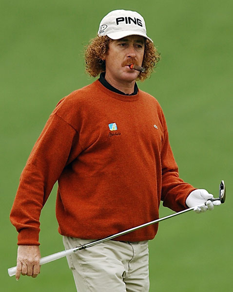 Miguel Angel Jimenez, sans pony tail, enjoys one of his trademark cigars during a practice round at the 2003 Masters. He shot 76-77 and missed the cut.