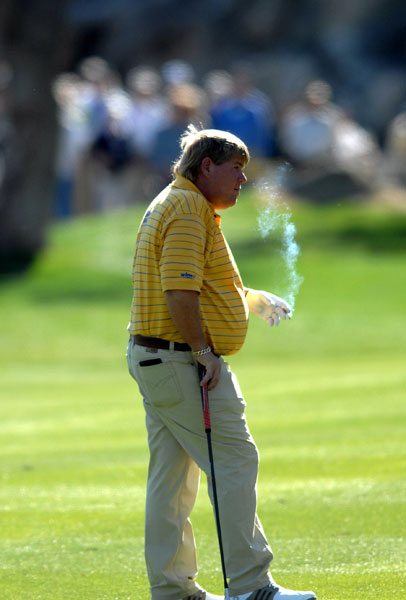 John Daly smokes during the third round of the 49th Bob Hope Chrysler Classic in January 2008. Daly later slimmed down closer to 220 pounds.