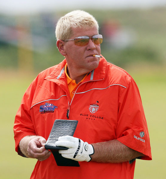 John Daly smokes a cigarette as he checks his yardage book during the third round of the 2009 Open Championship at Turnberry. Daly, the 1995 Open Champion, finished at +4, six shots behind Tom Watson and eventual champion Stewart Cink.