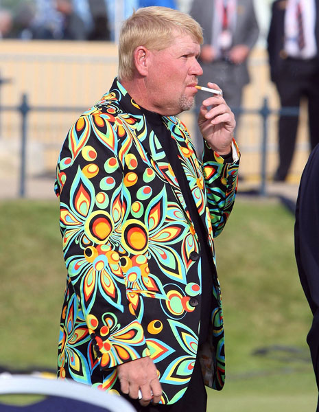 A colorfully-attired John Daly smokes during a photo shoot for past Open champions at St. Andrews in 2010. Daly carded a first-round 66 but finished +1, 17 shots behind winner Louis Oosthuizen.