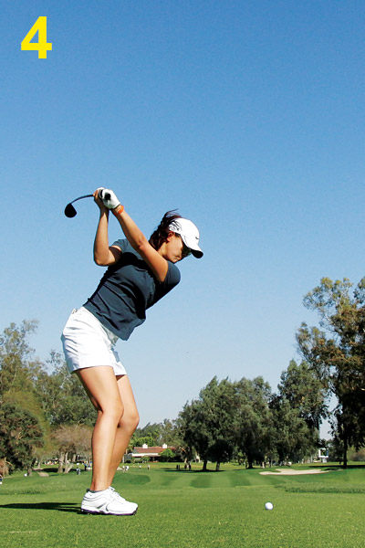 4. As she makes her transition to the downswing, notice that her hands and arms have dropped but her shoulders and hips haven't moved. If you open up too early, you'll usually end up throwing the club 'over the top' to get to the ball.