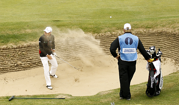 Zach Johnson got a blast of sand in his face after hitting out of a bunker on No. 6.