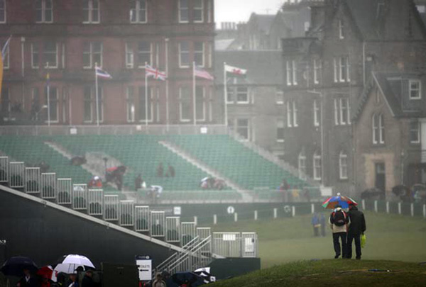 Heavy rain and wind blew through St. Andrews on the eve of the 150th British Open.