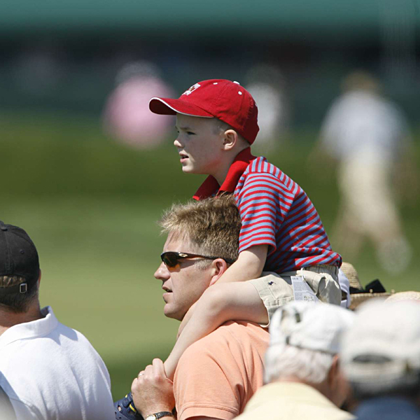 A young fan tried to get a better view of the action Friday.