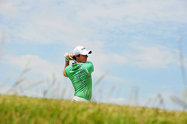 Rory McIlroy is only four strokes back after a one-under 69.