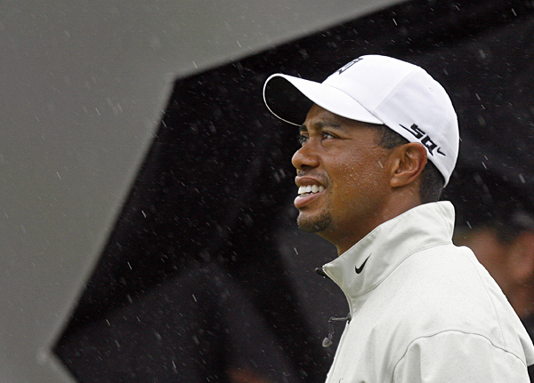 Tiger Woods, who practiced Monday at Carnoustie in the rain, is trying to win his third consecutive British Open.