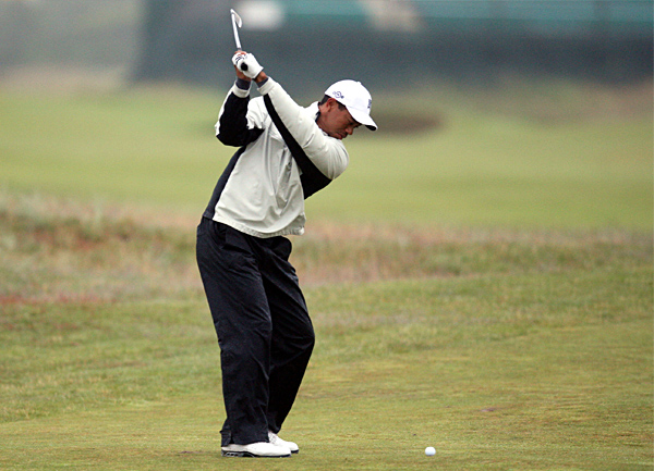 Woods hit an iron into the 13th green at Carnoustie.