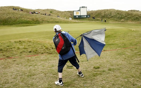 A boy struggled with his umbrella as high winds pounded Royal Birkdale.
