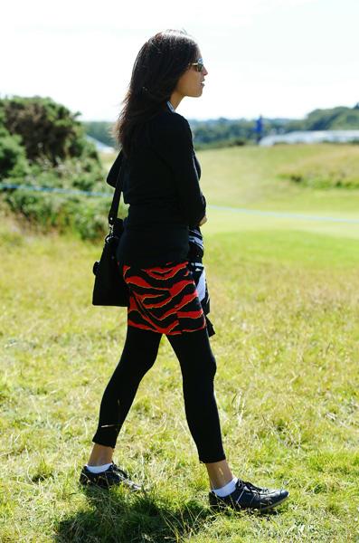 Daly's girlfriend, Anna Cladakis, followed along in matching pants.