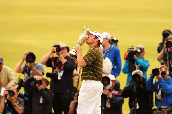 Louis Oosthuizen built a five-shot lead through two rounds at the British Open at St. Andrews, then surprised the world by rolling nearly unchallenged to a seven-stroke victory that came the same day South Africa celebrated Nelson Mandela's 92nd birthday.