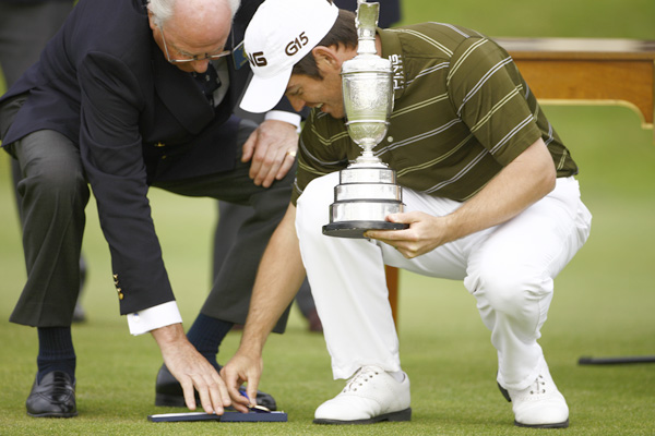 Oosthuizen dropped the gold medal, but he had a good grip on the claret jug.