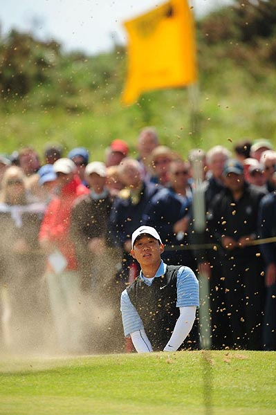 Anthony Kim's first major victory was still within reach at the turn as he kept close to the lead at eight over par.