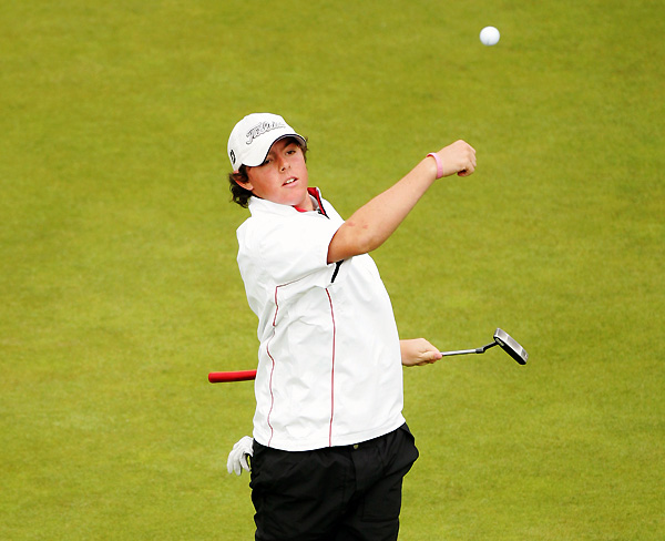Northern Ireland's Rory McIlroy tossed his ball after finishing with a 72. As the only amateur to make the cut at Carnoustie, he won the silver medal, which is awarded to the top amateur.