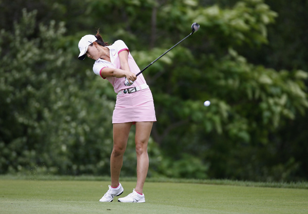 Michelle Wie is in the hunt, but she stumbled late with a double bogey on 18.