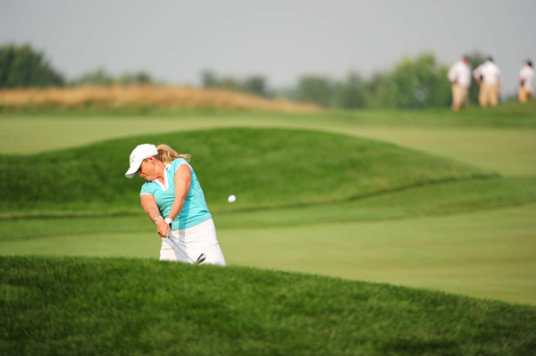 shares the clubhouse lead with Brittany Lang at 1-over par. Thunderstorms washed out afternoon play at Oakmont. The second round will resume Saturday at 7:30 a.m.
