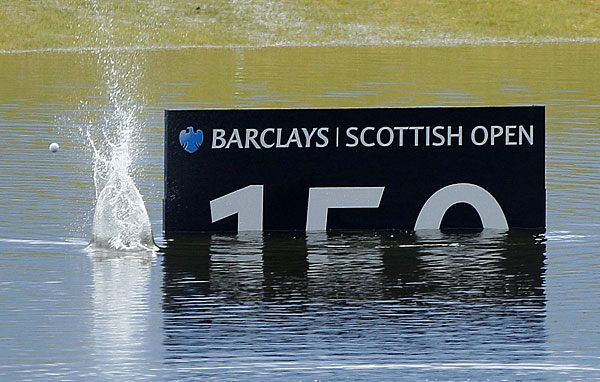 Players kept loose by skipping shots on the flooded driving range.
