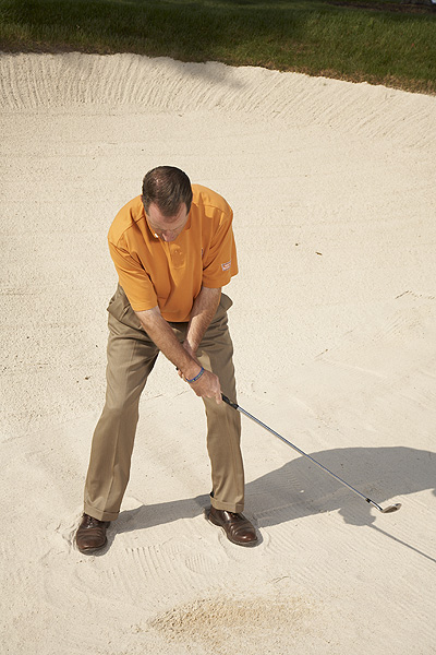 DON'T DO THIS!                                                      As you flip the clubhead past your hands, don't slap it to the left. Your right hand should flip under your left hand so that the clubface points straight up in your follow-through, not back behind you.
