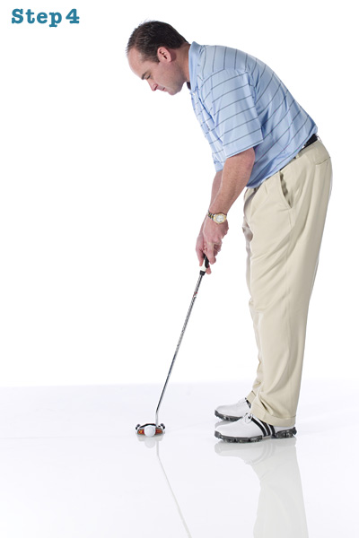 STEP 4 Once you're settled, turn your eyes down to the ball. Look at the hole once to identify the distance and then pull the trigger. Don't re-aim the putter again — you've already set the alignment you need from behind the ball.