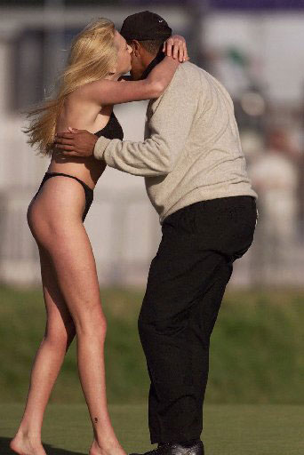 1999 British Open at Carnoustie: She was fined $160 for her antics, after planting a kiss on Tiger's cheek.