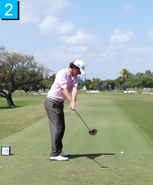 2. Nice takeaway, with the club outside of his hands and his hips resisting. If your hips move too early in your backswing, you can't create the coil between your lower and upper body you need for long drives.