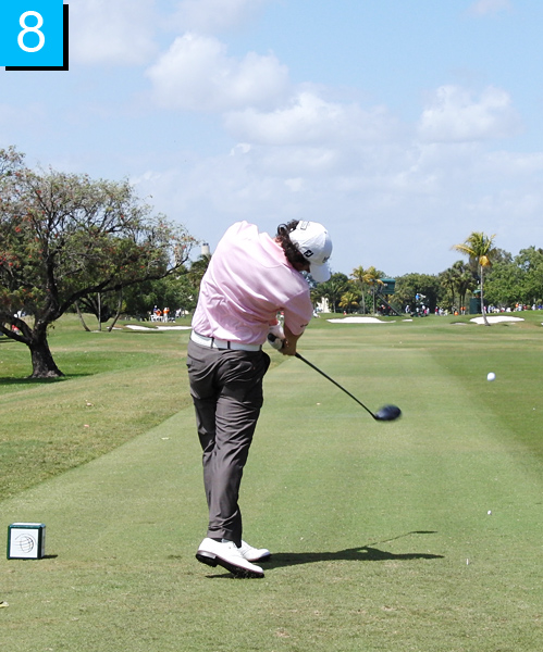 8. Everything continues to rotate through impact. Notice how the butt end of the club is still pointing at the middle of his chest and the clubhead is back out in front of him.