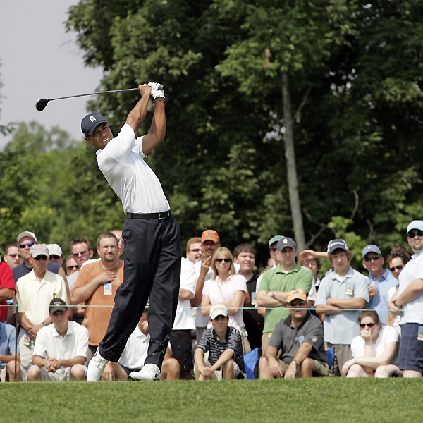 Woods made two birdies on the back to shoot a two-under 70.