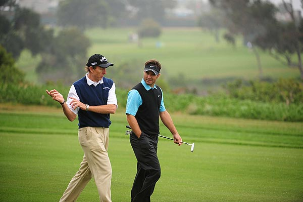 Masters champion Trevor Immelman got some swing advice from his coach, David Leadbetter, during his practice round Tuesday.
