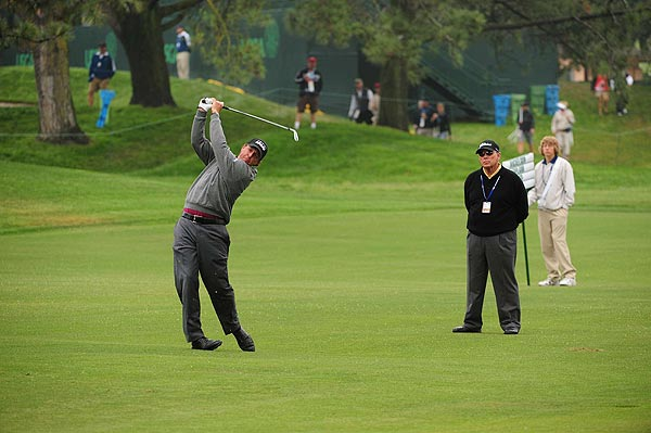 Phil Mickelson also hit the course today with his coach, Butch Harmon, looking on.