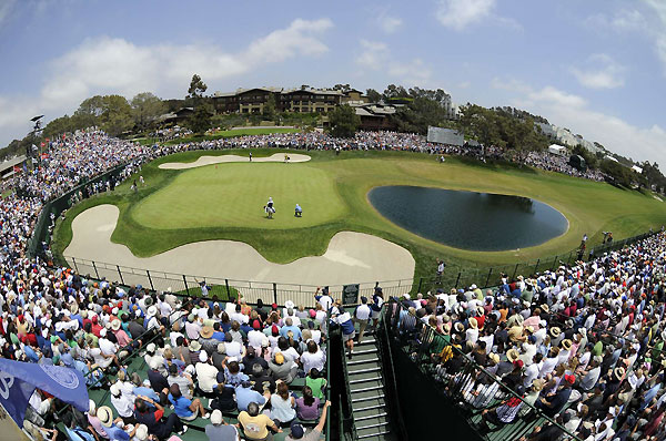 Fans watched Tiger Woods line up a putt on 18 Thursday.