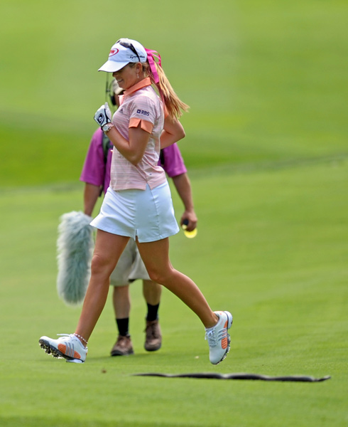 Paula Creamer ran to avoid a snake that slithered across the 14th fairway.