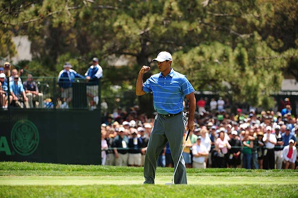 Woods shot one-over 72 in a round that included two double bogeys. (More pictures of Woods, Mickelson and Scott.)